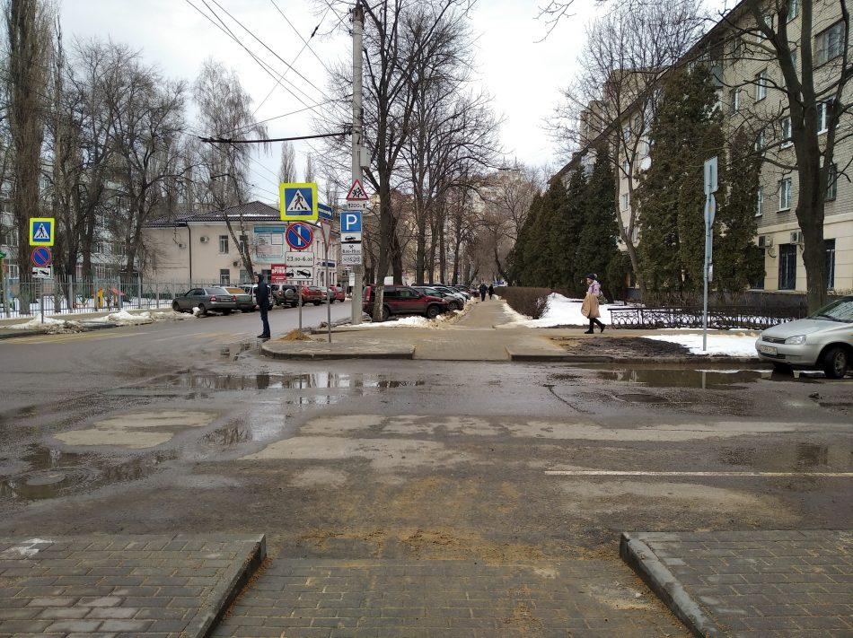 Лужи и снег: смотрим дорогу на Фридриха Энгельса после масштабного ремонта (12 незабываемых фото)